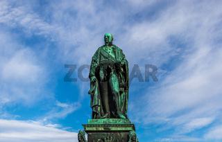 Detail view on Monument of Karl Friedrich von Baden with blue sky in background. Near Castle Karlsruhe, Baden-Wurttemberg, Germany