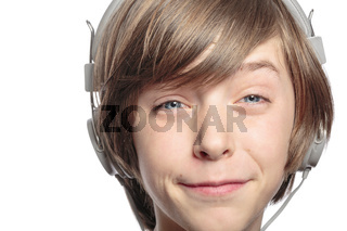 male teenager with headphones hurts the music, isolated on white