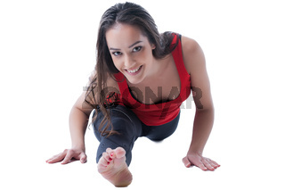 Happy brunette doing gymnastic splits, close-up