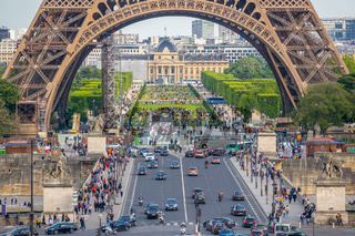 Cars and Tourists Near the Eiffel Tower on the Jena Bridge