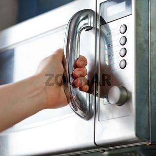 opening of microwave oven door