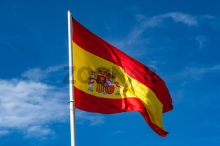 Flag of Spain over blue sky background