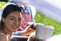 Asian customer make contactless mobile payment Drive thru