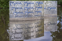 Work of art in the river Saale - mirror writing