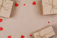 Gifts in craft paper and red hearts