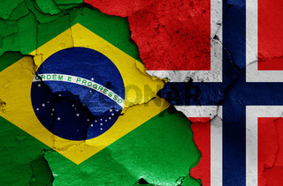 flags of Brazil and Norway painted on cracked wall