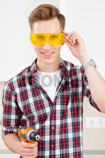 builder with a dril