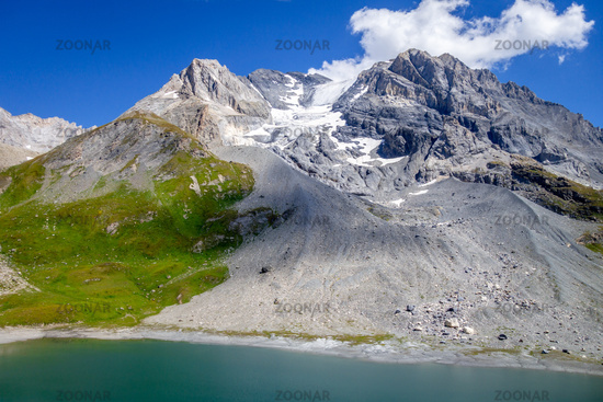 Long lake and Grande Casse Alpine glacier in French alps