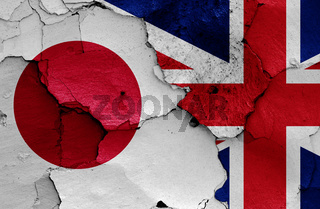 flags of Japan and UK painted on cracked wall