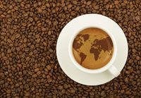 Espresso cup with world map on coffee froth crema