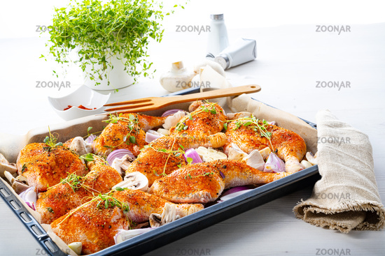 Prepared chicken legs with various vegetables and herbs