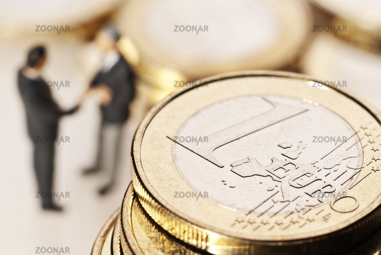 Euro coins and businessmen