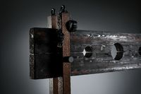 Handcuffs hanging on pillory for BDSM session