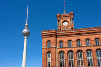 The famous Television Tower and the town hall in Berlin in front of a clear blue sky