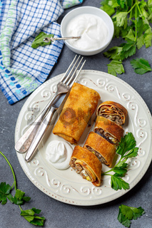 Crepes with meat and egg. Traditional Russian cuisine.