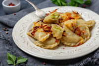 Dumplings stuffed with stewed cabbage and onions.