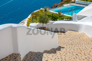 Staircase and Swimming Pool on a Sunny Day in Santorini