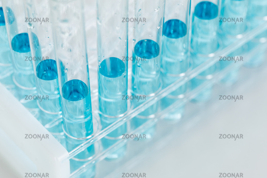 Abstract of Scientific Test Tubes Containing Blue Chemical In Rack
