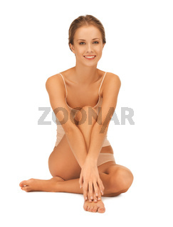 woman in cotton underwear touching her legs