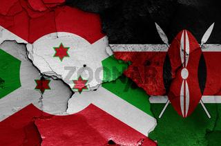 flags of Burundi and Kenya painted on cracked wall