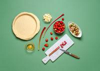Making a pie at home. Strawberries and rhubarb pie ingredients