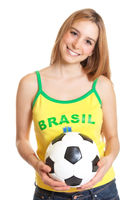 Laughing brazilian sports fan with ball