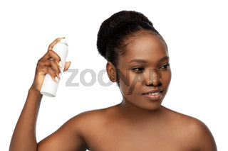young african woman with hairspray