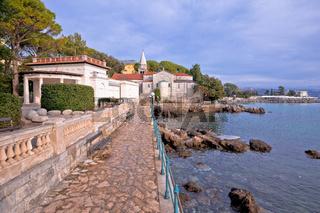 Adriatic town of Opatija watefront walkway and church view