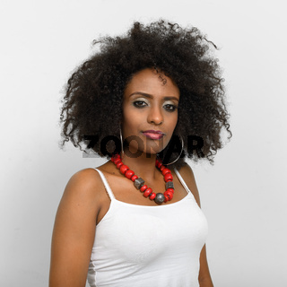 Portrait of young beautiful African woman with Afro hair