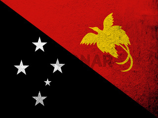 The Independent State of Papua New Guinea National flag. Grunge background
