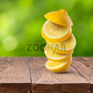 Fresh lemon cuts on wooden table