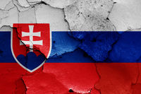 flags of Slovakia and Russia painted on cracked wall