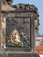 Base of John of Nepomuk statue on the Charles bridge in Prague