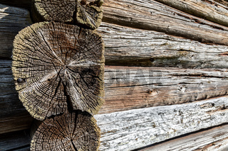 Old rough wooden logs with cracks as background