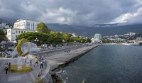 The Central promenade, the statue of the Dolphin and the view of the city of Yalta in the Republic of Crimea, Russia. On the evening of September 7, 2020