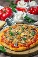 Pizza with mushrooms and cheese. Italian cuisine.
