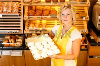 Bakery shopkeeper presents meringue