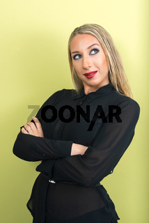 Portrait of young beautiful blonde businesswoman thinking