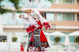 People in traditional folk Bulgarian costumes