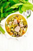 Soup Eintopf in bowl on board top