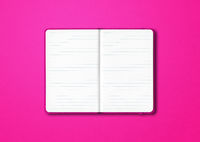 Pink open lined notebook isolated on colorful background