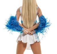 Back view of slim leggy blonde posing with pompons