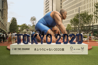 TOKYO, JAPAN - August 16, 2018: Event 'Be the change Tokyo 2020' organized on the theme of the future Olympic Games in Tokyo in 2020. In the Tokyo Midtown area of Hibiya stood a huge inflatable structure in the shape of an athlete at the start of a race.