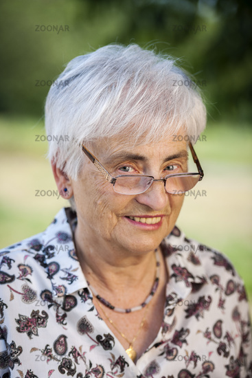 Cheeky look over the glasses of a pensioner