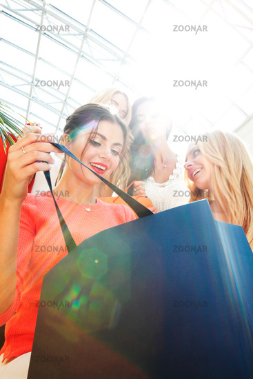 Women look inside shopping bag