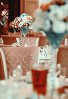 Beautifully decorated of luxury wedding banquet at restaurant. Bouquet of flowers on served tables. Life event, wedding or birthday reception, no people