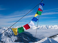 Prayer flag in fron of peaks