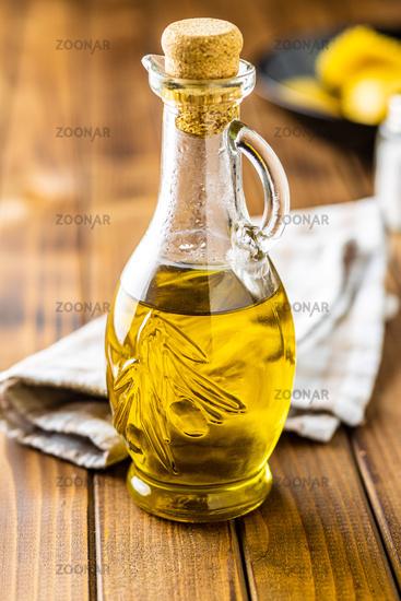 Olive oil in glass bottle.