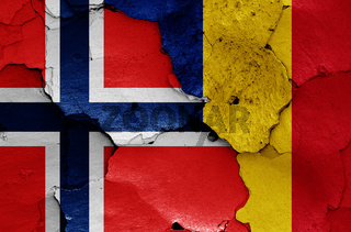 flags of Norway and Romania painted on cracked wall