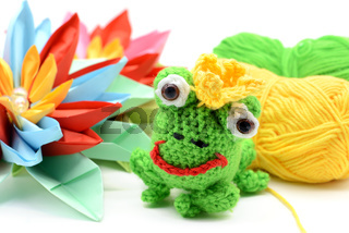 crocheted frog king with crown and paper water lily.